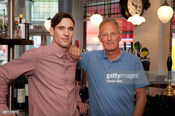 Father and son in bar
