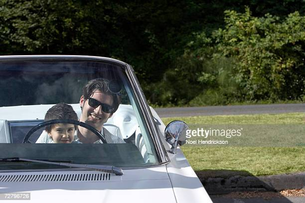 father and son (3-4 years) in convertible car - 25 29 years stock pictures, royalty-free photos & images