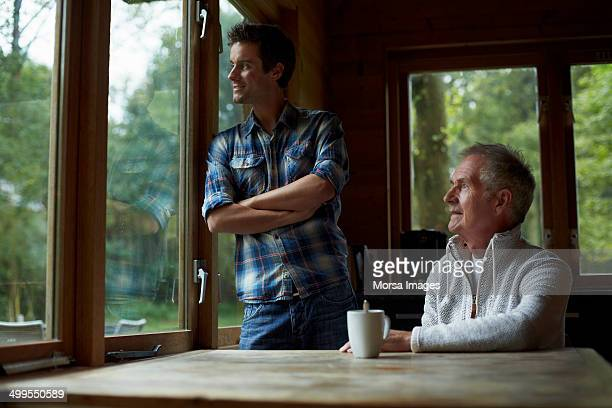 Father and son in cottage
