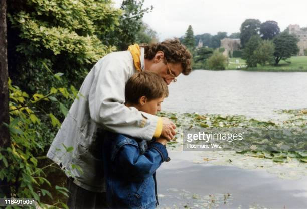 father and son in english parkland - 1985 stock pictures, royalty-free photos & images