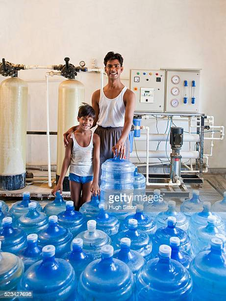 father and son in family run clean drinking water production plant - hugh sitton imagens e fotografias de stock