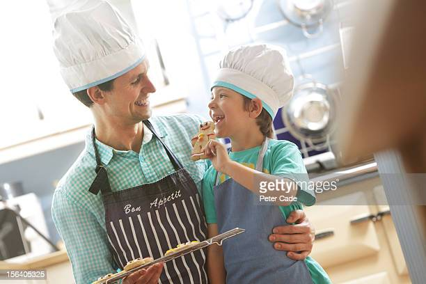Father and son in kitchen, baking
