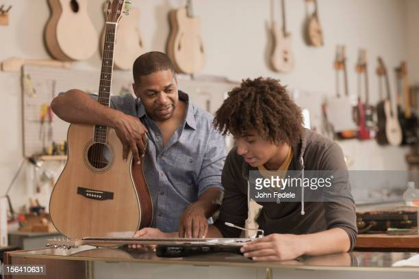 Father and son in music workshop