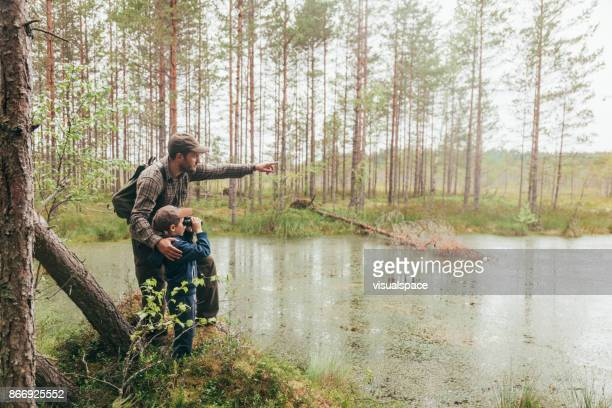 father and son in nature together - bog stock photos and pictures