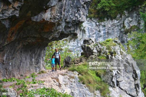 Father and son in Route Of Las Xanas Gorge. Asturias, Spain.