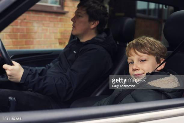father and son in the car together - sally anscombe stock pictures, royalty-free photos & images