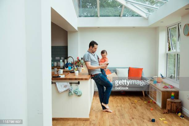 father and son in the kitchen - wide angle stock pictures, royalty-free photos & images