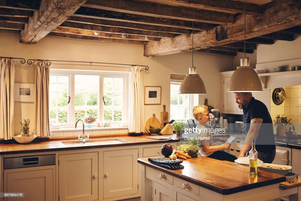 Father and son in the kitchen : Stock Photo