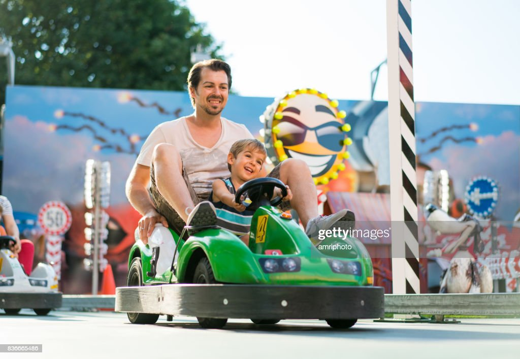 father and son in toy car : Stock Photo