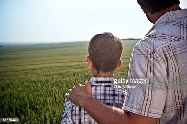 Father and son in wheat-field