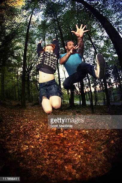 Father and son jumping