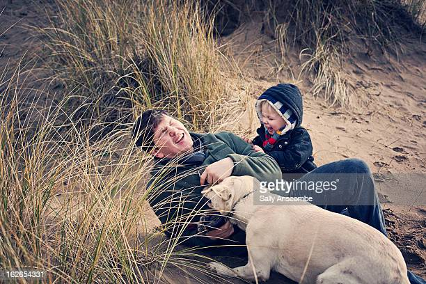 Father and son laughing on the beach