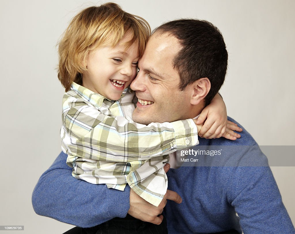 Father and son laughing : Stock Photo