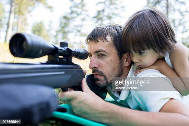 Father and Son learning hunting