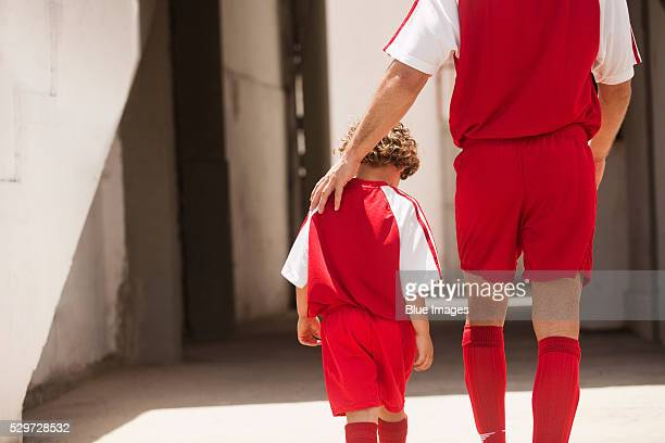 Father and son leaving soccer stadium