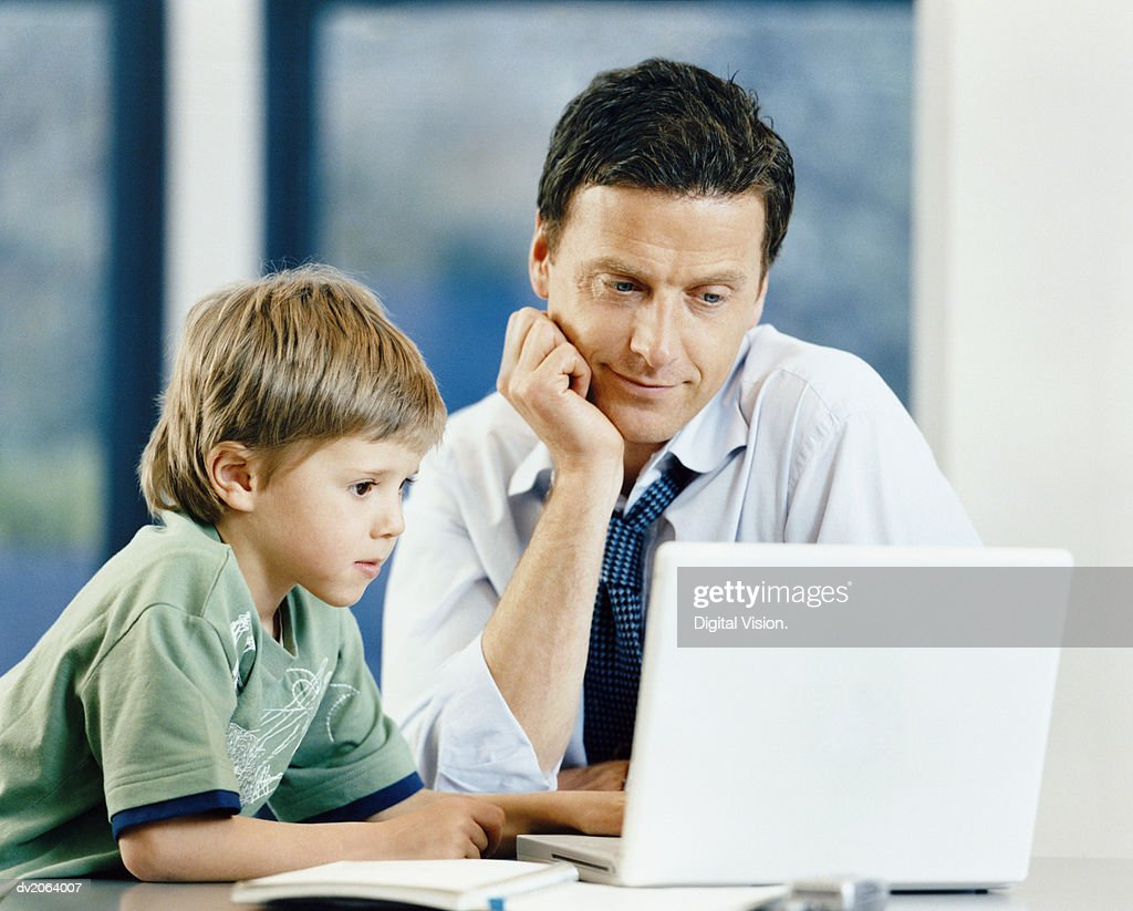 Father and Son Looking at a Computer : Stock Photo