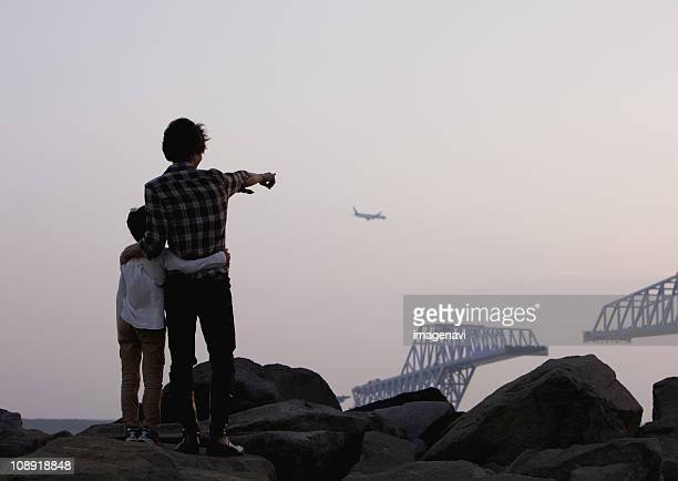 Father and son looking at airplane