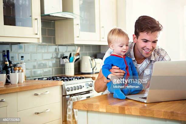 father and son looking at laptop - 7894 stock pictures, royalty-free photos & images