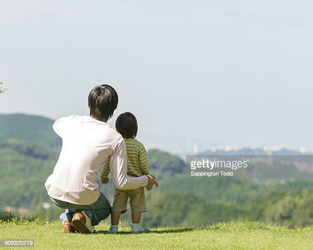 Father And Son Looking At View