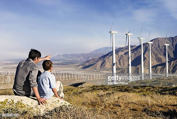 Father and Son Looking at Wind Farm