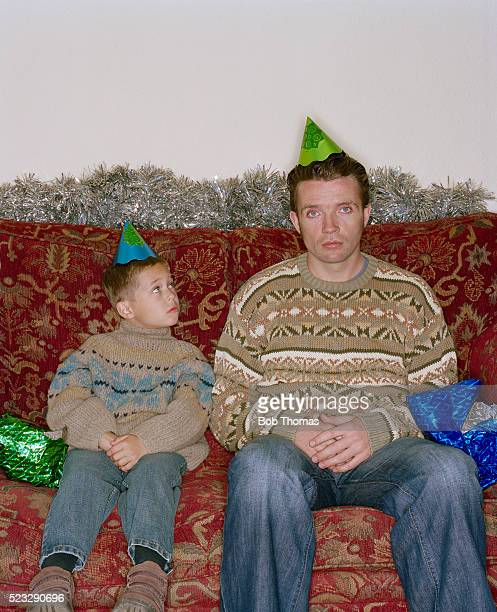 Father and Son Looking Depressed at Christmas Gathering