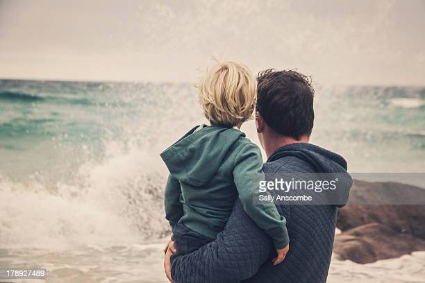 Father and son looking out to sea