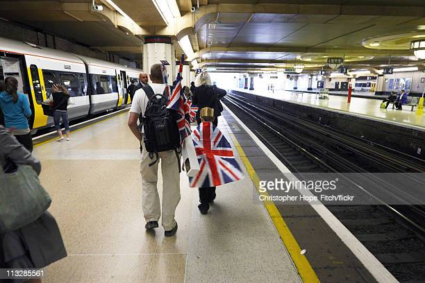 Father and son make their way home with union flags at Charing Cross Station following the Royal Wedding of Prince William to Catherine Middleton, on...