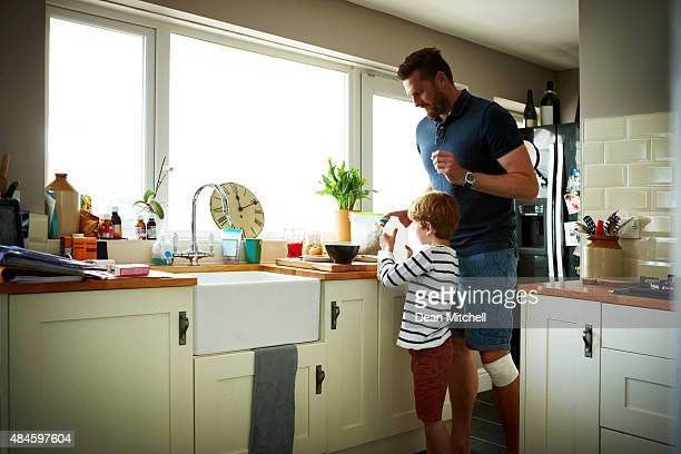 Father and son making breakfast