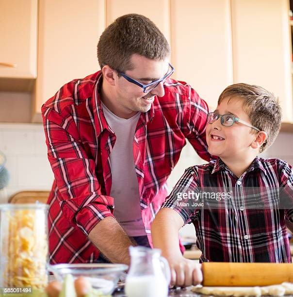 Father and son making cookies