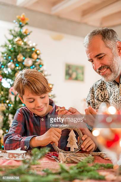 Father and Son Making Homemade Christmas Decoration