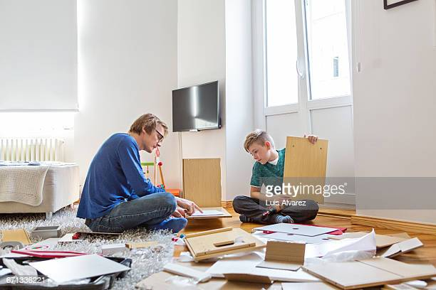 Father and son making project with wooden planks