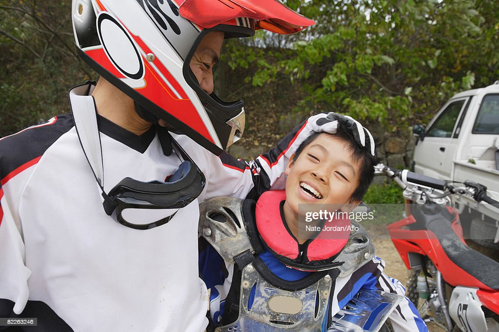 Father and Son Motocross Riders : Stock Photo