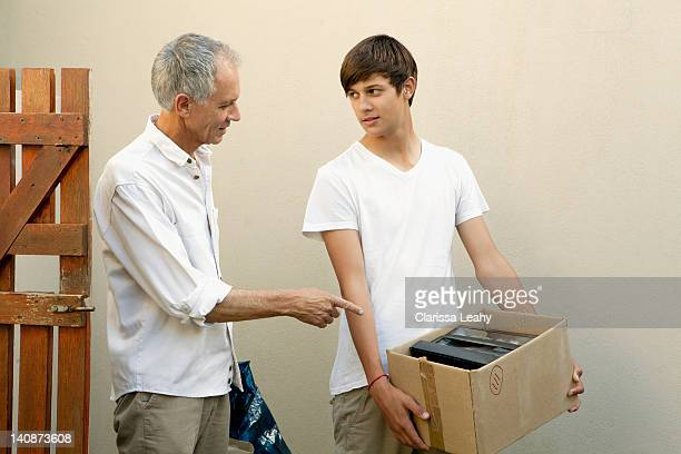 Father and son moving boxes