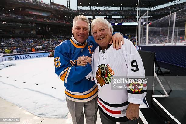 Father and son NHL Hall of Famers Bobby Hull and Brett Hull pose for a photo during the 2017 Bridgestone NHL Winter Classic at Busch Stadium on...