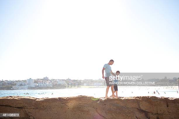 Father and son North Bondi walking on rocks