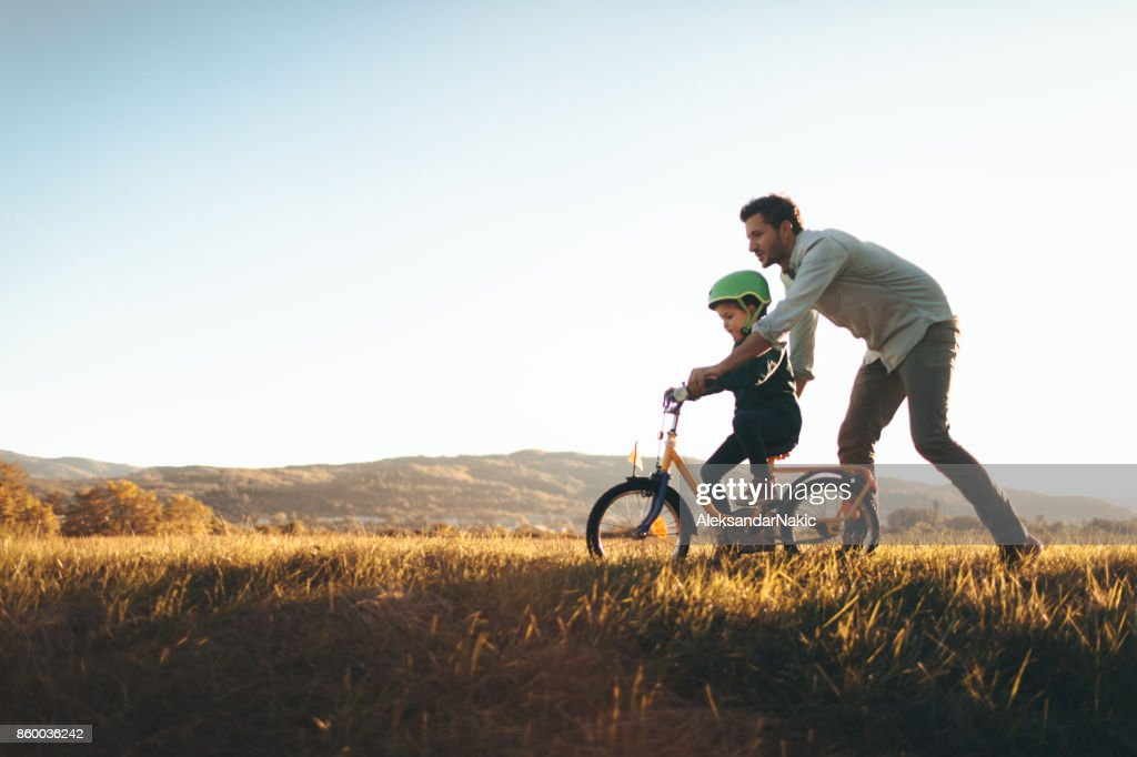 Father and son on a bicycle lane : Stock Photo