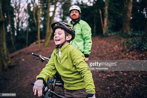 father and son on a bicycle ride together - recreational pursuit stock pictures, royalty-free photos & images