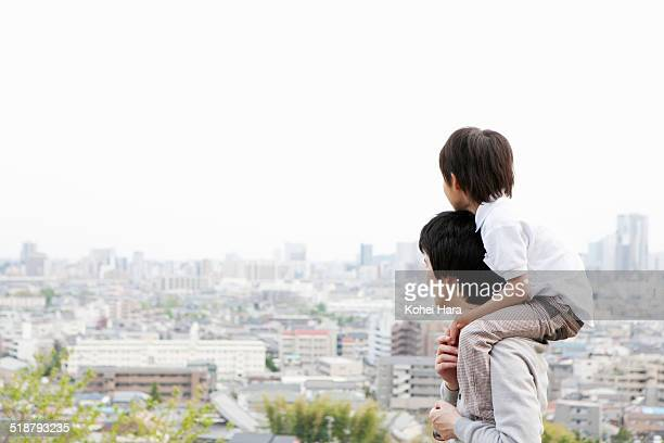 father and son on a hill - townscape stock pictures, royalty-free photos & images