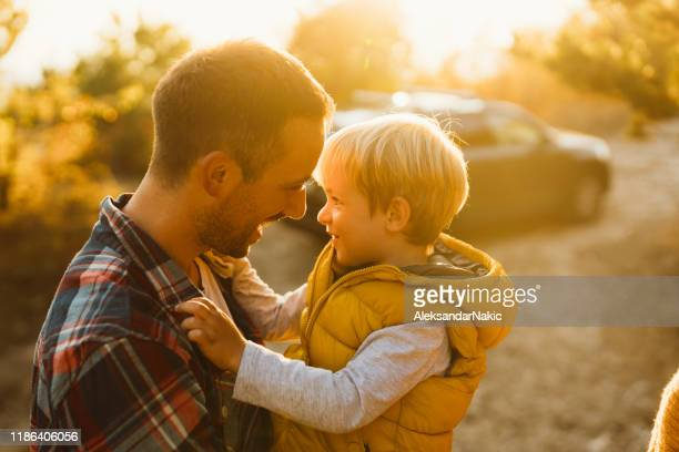 father and son on a road trip - simple living stock pictures, royalty-free photos & images