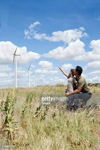 Father and son on a windfarm