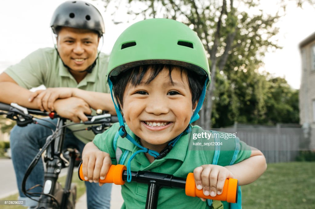 Father and son on bikes : Stock Photo