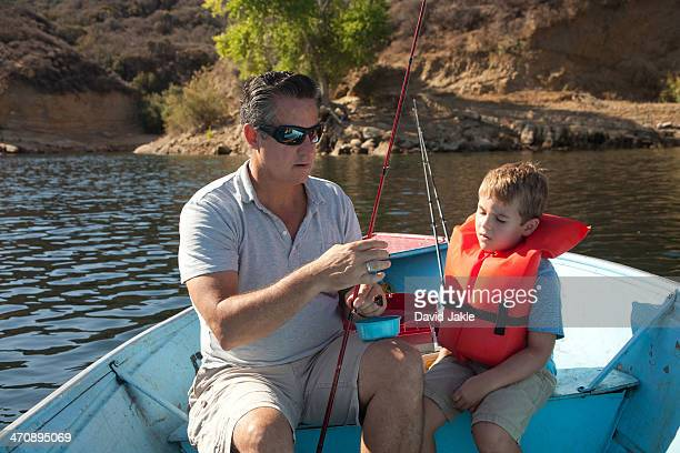 father and son on fishing trip - castaic lake stock pictures, royalty-free photos & images