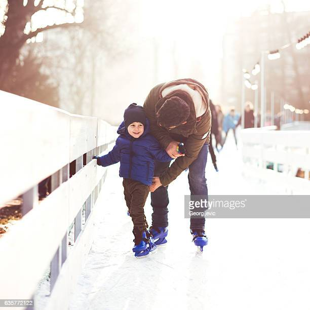 Father and son on ice skating