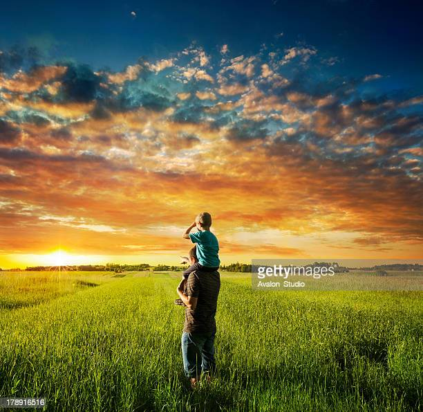 father and son on meadow - calculating stock pictures, royalty-free photos & images