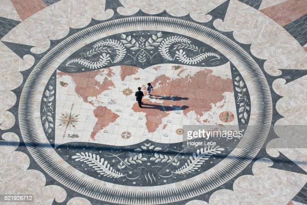 Father and son on mosaic map of the world seen from top of Padrao dos Descobrimentos