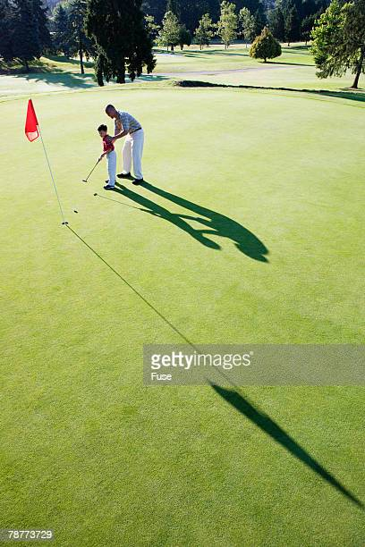 Father and Son on Putting Green