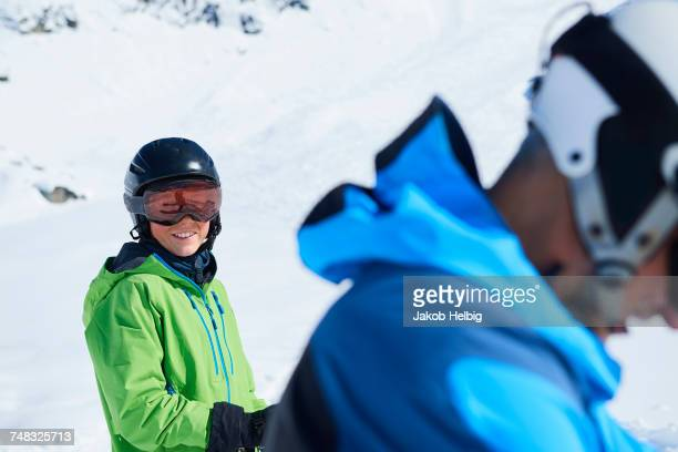 father and son on skiing holiday, hintertux, tirol, austria - sport d'hiver photos et images de collection