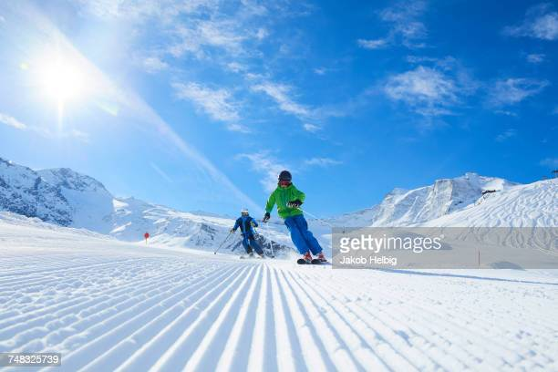 father and son on skiing holiday, hintertux, tirol, austria - ski holiday stock photos and pictures