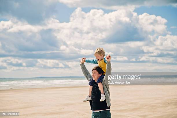 Father and son on the beach together