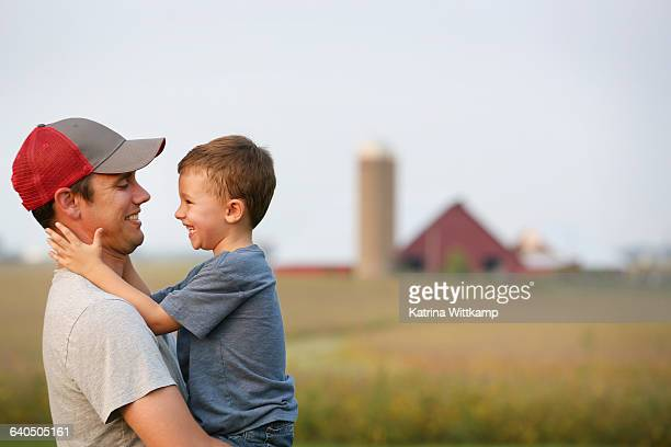 father and son on their family farm - famiglia con figlio unico foto e immagini stock
